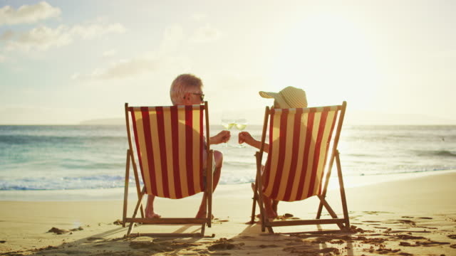 Happy Couple Relaxing Watching the Sunset on Vacation video