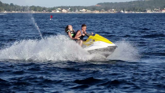 Happy couple riding jet ski. video