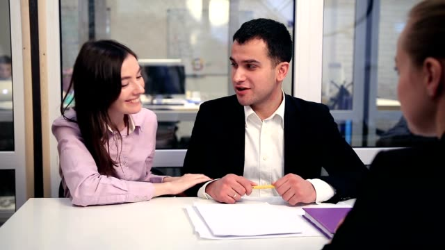 Happy couple signing real-estate contract video