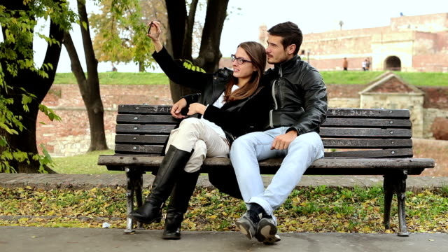Happy Couple Taking a Selfie Photo With Mobile Phone Outdoor video