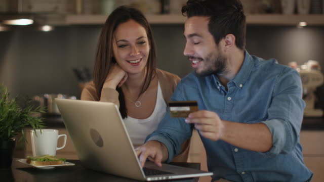Happy Couple Uses Laptop for Internet Purchases, Handsome Man Has Credit Card in His Hand. Happy Couple Uses Laptop for Internet Purchases, Handsome Man Has Credit Card in His Hand. Shot on RED Cinema Camera in 4K (UHD). shopping online stock videos & royalty-free footage