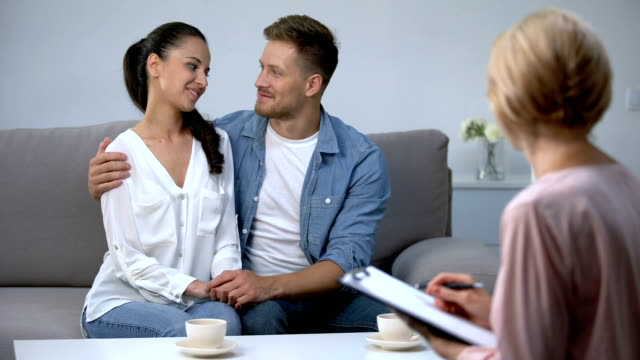Happy couple visiting social worker before adoption, preparation child custody