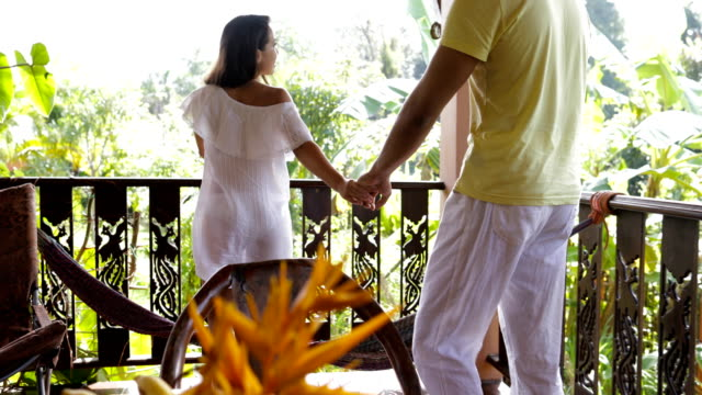 Happy Couple Walk To Summer Terrace Of Modern Villa Talking Outdoors, Mix Race Man And Woman In Love On Honeymoon Vacation video