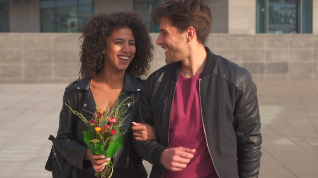 Happy couple walking outdoors video