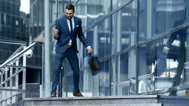 Happy Dancing Business Man Ride the Steps Handrail and Walks on the Business District Streets. video