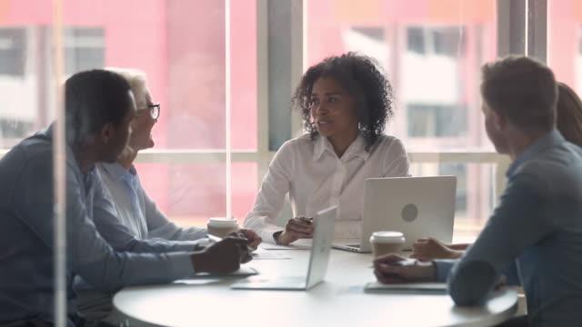 happy diverse businesswomen handshaking at international negotiations concept - fiducia video stock e b–roll