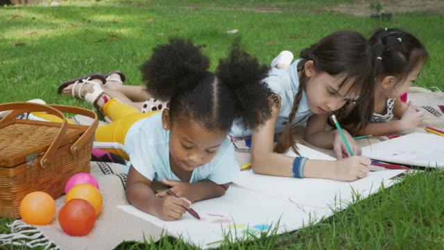 happy diverse kids painting - kids drawing стоковые видео и кадры b-roll