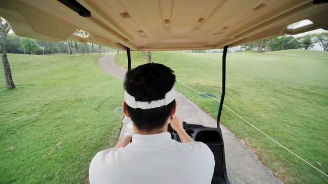 Happy driving a golf-cart with clubs golf.Sports Cinemagraphs