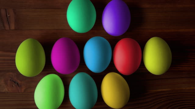 Happy easter! Colorful eggs for Easter on wooden background.