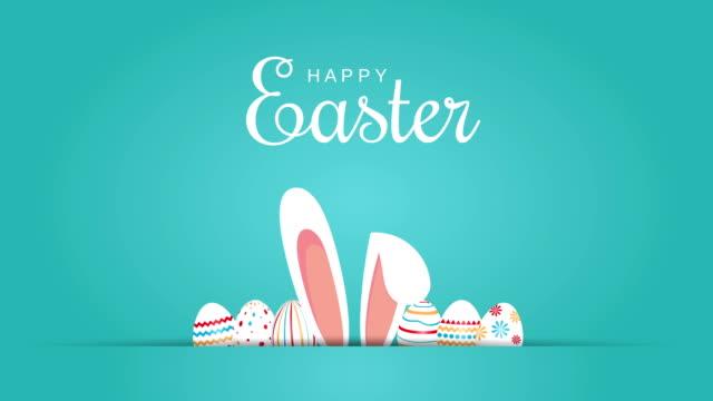 vídeos y material grabado en eventos de stock de feliz mensaje de pascua con huevos y orejas de conejo. animación 4k - pascua