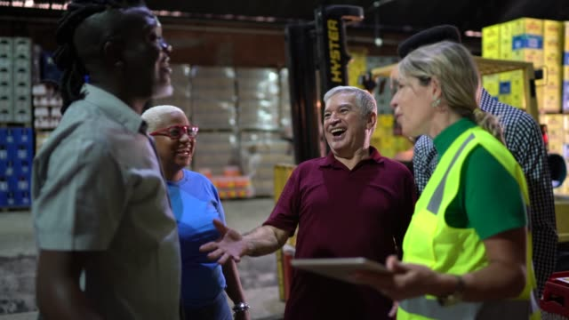 Happy employees celebrating together at warehouse Happy employees celebrating together at warehouse incentive stock videos & royalty-free footage
