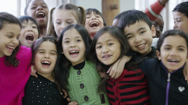 happy ethnic group of diverse third graders - classroom stock videos and b-roll footage