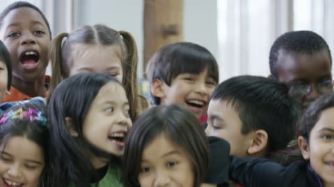 Happy ethnic group of diverse third graders Large group of third grade students that are close friends having fun child stock videos & royalty-free footage
