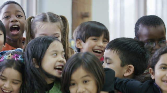 Happy ethnic group of diverse third graders Large group of third grade students that are close friends having fun group of people stock videos & royalty-free footage