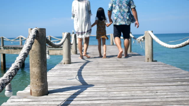 Happy Family Asian walking on a wooden bridge at the pier seaside.4k Happy Family Asian walking on a wooden bridge at the pier seaside.4k pacific islands stock videos & royalty-free footage