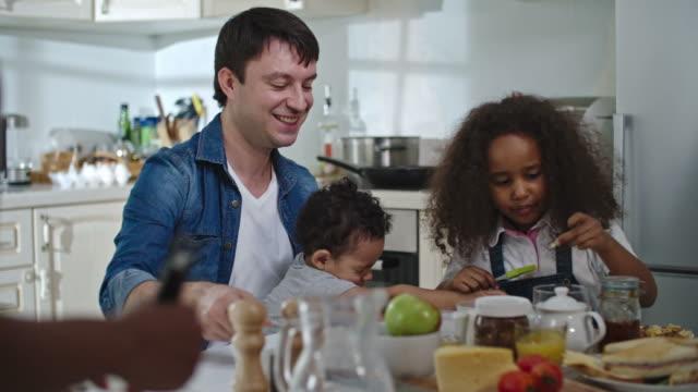 Happy family at breakfast video