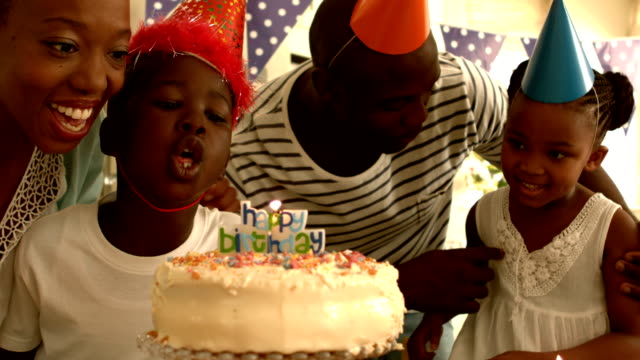 Happy family celebrating a birthday video