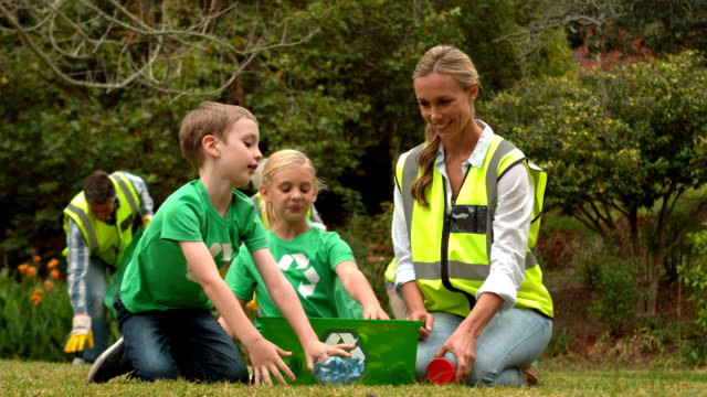 Happy family collecting rubbish video