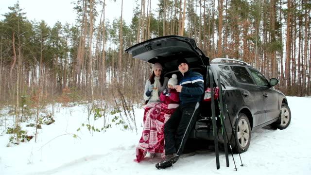 happy family drink tea and enjoy the winter landscape. - sprzęt sportowy filmów i materiałów b-roll