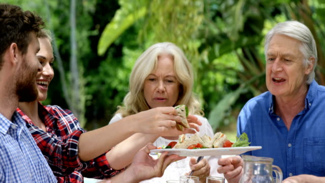 Happy family eating together video