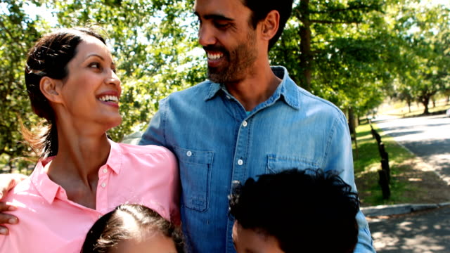 Happy family enjoying together in park Happy family enjoying together in park on a sunny day 30 39 years stock videos & royalty-free footage