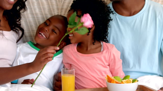 Happy family having breakfast in bed Happy family having breakfast in bed in slow motion mothers day stock videos & royalty-free footage