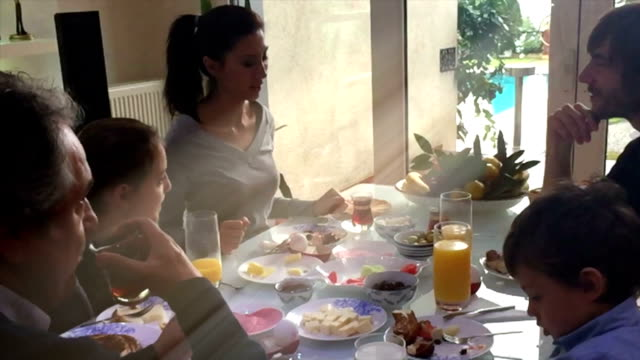 Happy family having breakfast together in hoiday video