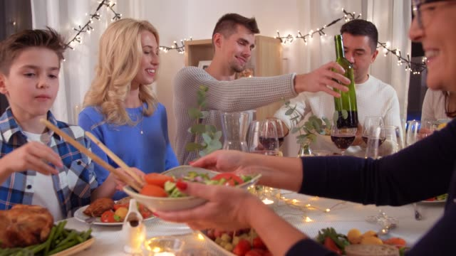 happy family having dinner party at home celebration, holidays and people concept - happy family having dinner party and eating at home baltic countries stock videos & royalty-free footage