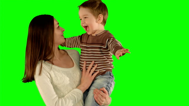 Happy family having fun on a Green Screen