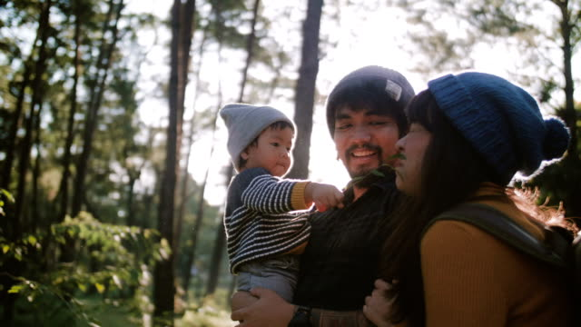 happy family in forest. - vacanze video stock e b–roll