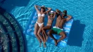 istock Happy family In swimming pool 861622404