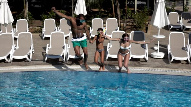 Happy family In swimming pool video