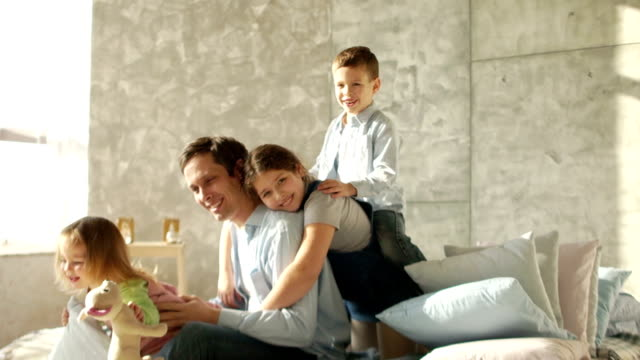 happy family in the morning. three children of different ages and a young father - fathers day stock videos and b-roll footage
