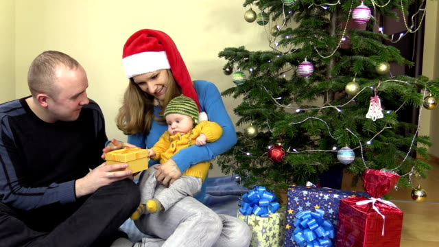 Happy family man and woman present gift for baby daughter video