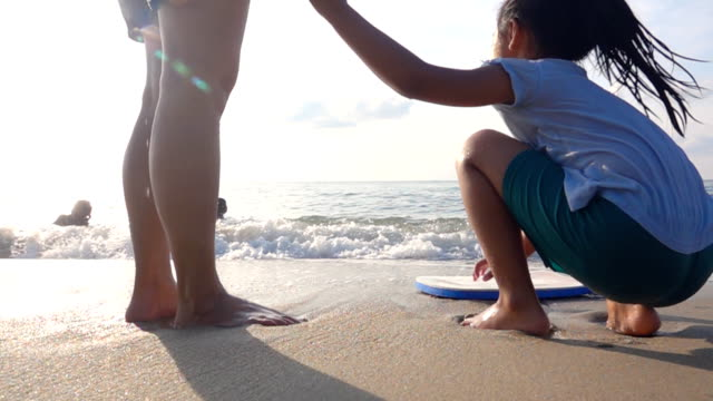 Happy Family, Mother and daughter on the Beach at Sunset, Slow motion