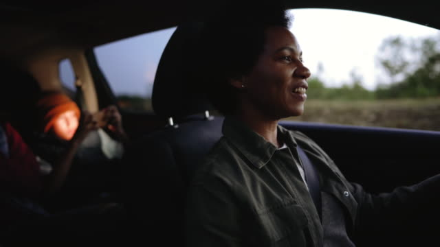 Happy family of three enjoying their time in a car video