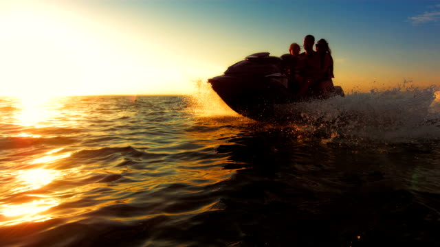 SLO MO Happy Family Riding A Jet Boat At Sunset video