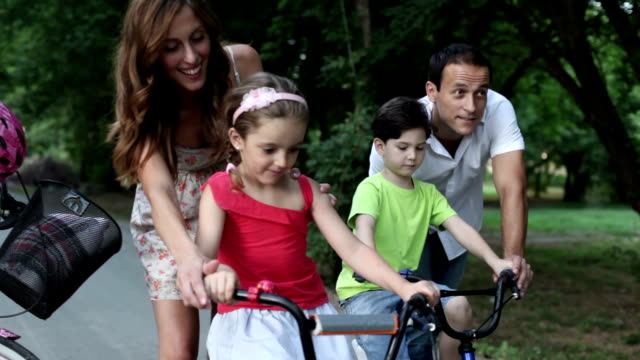 Happy Family Riding Bicycles in a park. video
