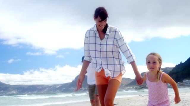 Happy family running at beach video