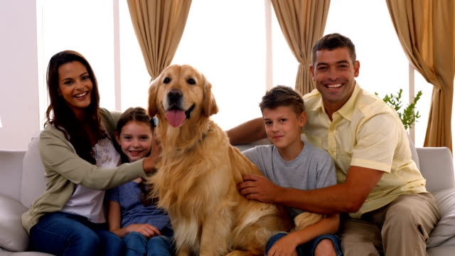 Happy family smiling with their dog video