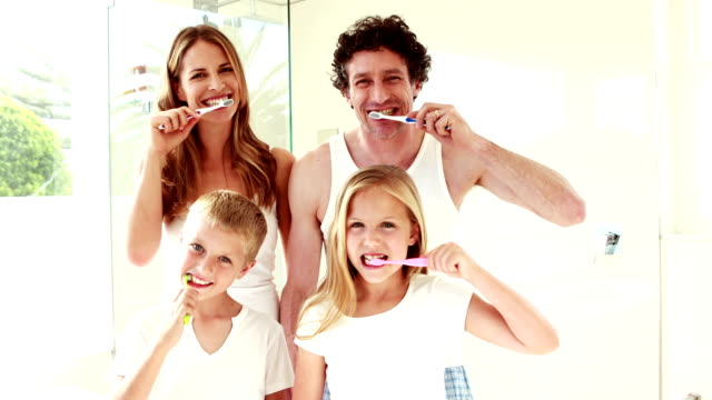 Happy family washing teeth together video