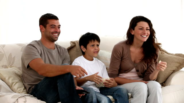 Happy family watching television video