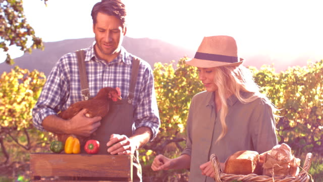 Happy farmer couple and their products in slow motion video