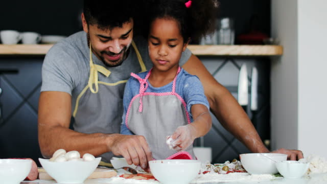Happy father and daughter preparing food video