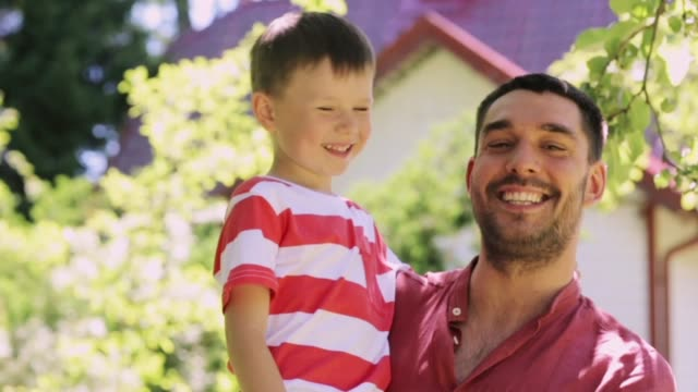 happy father and little boy outdoors - fathers day stock videos and b-roll footage