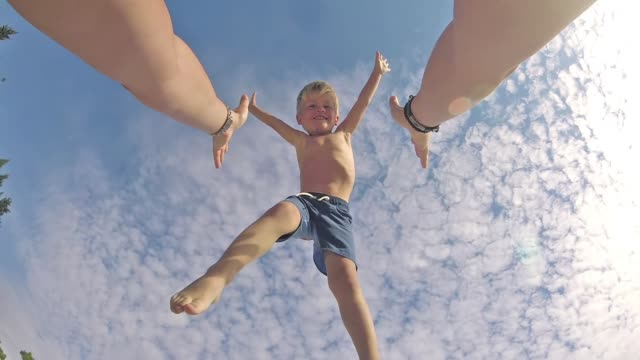 happy father and son playing on tropical beach, carefree happy fun smiling lifestyle - fiducia video stock e b–roll