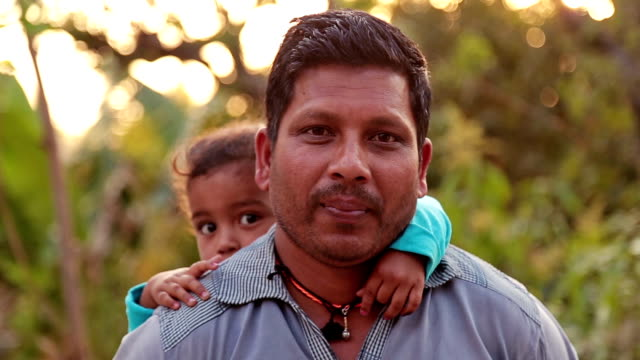 Happy Father Carrying His Son On His Back video