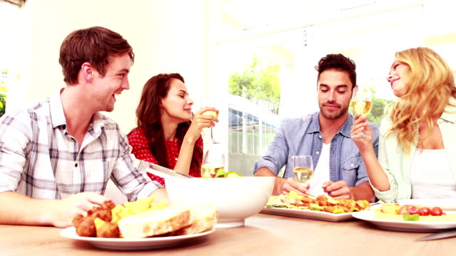 Happy friend having lunch and drinking wine video