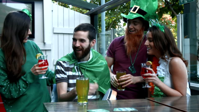 Happy friends celebrating St Patrick video