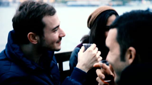 Happy friends drinking hot tea in Istanbul, Turkey video